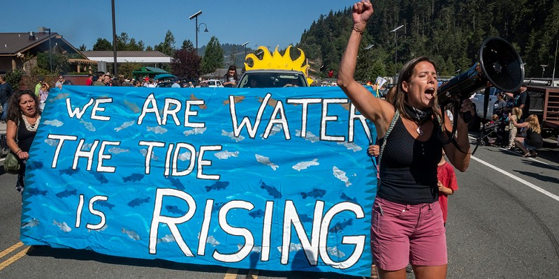 This participant in the 2019 Klamath Salmon Festival parade led chants in support of tribal water rights, dam removal and environmental protection.