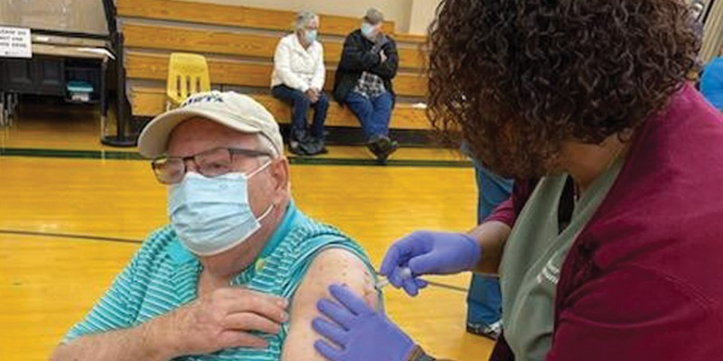 Dale Stocky celebrates his 75th birthday by getting the COVID-19 vaccination he'd newly become eligible for at a Mad River Community Hospital vaccine clinic Jan. 23 at Pacific Union Elementary School.