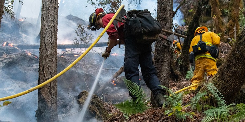 Crew work on hot spots at the Knob Fire.