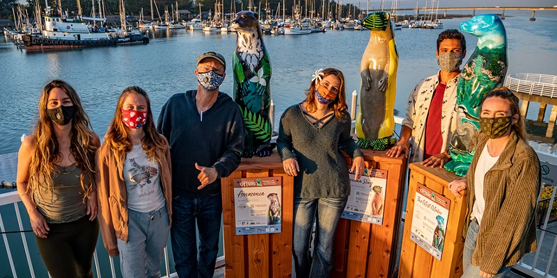 HSU wildlife professor Jeff Black gathered team members from his North Coast Otters Public Arts Initiative at the Humboldt Bay Aquatic Center on Monday for one last sunset view over Humboldt Bay with three of the project's painted otters. From left:  Kelly Mottershead (volunteer), and four HSU wildlife major students with professor Black (third from left): Katherine Larson, Korinn Trinies, Ben Sparks and Em Harvey.