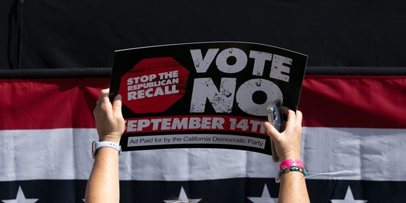 A Gavin Newsom supporter holds up a sign against the recall election at a campaign event at the IBEW-NECA training center in San Leandro on Sept. 8, 2021.