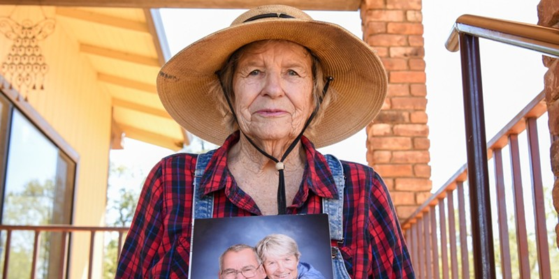 Johanna Trenerry of Happy Valley holds a photograph of herself with her husband, Art Trenerry, who died last year of COVID-19 while staying at Windsor Redding Care Center. His family members, including Johanna, are named as plaintiffs in a lawsuit against the facility.