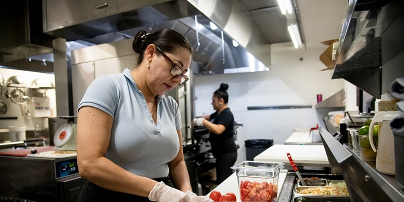 Cook Martha Garcia preps food in the kitchen at Verde Mexican Rotisserie in South Lake Tahoe on Oct. 6, 2021. Domi Chavarria, the owner of Verde Mexican Rotisserie, lost about $10K worth of inventory when they shut down for two weeks due to the Caldor Fire evacuation.