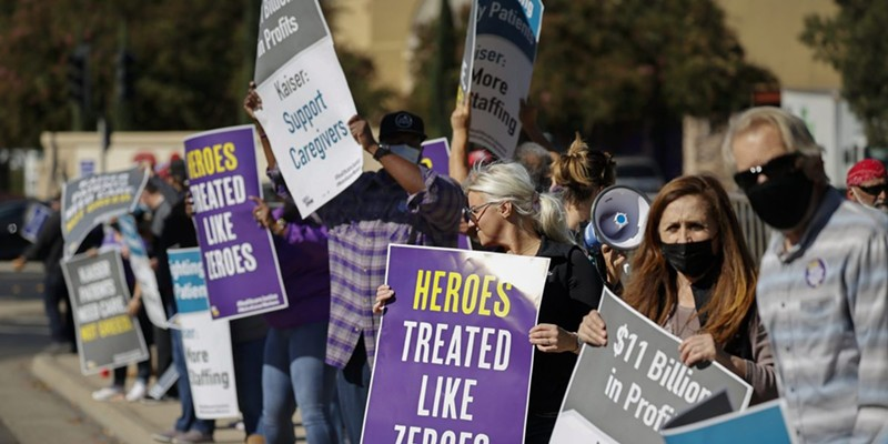 Hospital staffers and union organizers waved signs and banners in protest over staffing shortages at Kaiser Permanente Hospital in Roseville on Oct. 14, 2021.