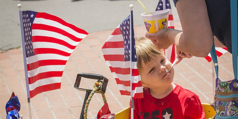 Fourth of July 2016 Mason Allen, 3, of Eureka, shared a treat with his mother, Ellie, during the Fourth of July Festival in Eureka along five blocks in Old Town. Mark Larson