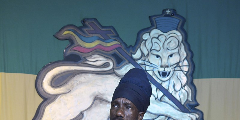 """Sizzla Kalonji addresses the media at a press conference after his show. Prior to the press conference, Kalonji's manager warned reporters not to ask any """"homophobic questions."""""""