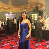 Oscars 2017 All in blue, Wendy Burns' fascinator was a gift from her husband. Jennifer Fumiko Cahill