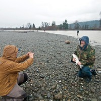 Steelhead Days Tim Havens poses with his first steelhead on the Mad River as Jean Christophe Worth catches the picture.