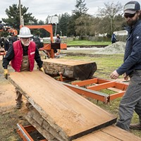 New Slideshow Jim Evans (left), of Sheridan, California, recruited bystanders to help with newly cut wood boards that he cut on the Wood-Mizer band mill he was demonstrating. Photo by Mark Larson