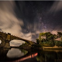 Historic Fernbridge sits out in the cosmos beneath a layer of sweeping clouds and the majestic Milky Way. Mars is bright at center. The lights from passing cars illuminated the shore and provided the reflections. Sept. 11, 2018.