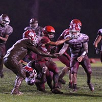 McKinleyville Panther running back Caleb Martinez is swarmed by Hoopa Warrior defenders. It was a wet and muddy affair as the Warriors took advantage of a slick field to pound out a win over the homecoming-celebrating McKinleyville Panthers 22-12 Saturday night.
