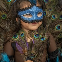 This young girl rocked maximum plumage with her beautiful peacock costume.