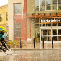 A cyclist braves the downpour on the trip through Humboldt State University's campus.