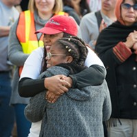 Charmaine Lawson hugs Sadie Shelmire, 11, after Shelmire spoke of the racism she has experienced in Humboldt County.