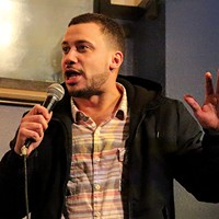 Luigi Diaz performs at the Savage Henry Comedy Club.