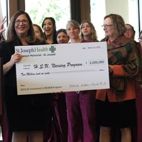 Humboldt State University President Lisa Rossbacher (right) receives a $2 million check from St. Joseph Hospital for the university's new nursing program.
