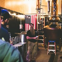 Steve Bohner gives visitors a tour of the distillery.