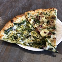 Pizza with pesto and brie in Trinidad.