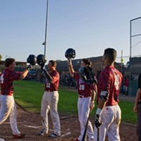 Bryce Kirk is congratulated by his team after hitting his second home run of the game