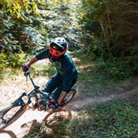 A rider takes on a drop and prepares for another on the trail through Green Diamond property a day ahead of the Mad River Enduro race.