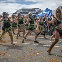The flower blossom-strewn east side of the Arcata Plaza made a good dance platform for the Samba da Alegria dancers.
