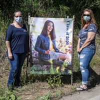 Two of the organizers of the special event, Lori Ruiz, left, and Michelle Bushnell, stand with another of the senior portraits.