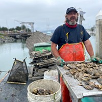 Sebastian Elrite, owner of Aqua-Rodeo Farms, sells Pacific oysters from his berth on B dock.