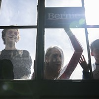 Supporters peer through the window during a Bernie Sanders presidential campaign event at Craneway Pavilion in Richmond, CA on February 17, 2020.