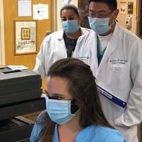 Registered nurse Melanie Smits (foreground) with hospitalist Paul Shen and registered nurse Celene Olson.