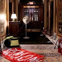 "A discarded flag reading ""Treason"" lays on the floor inside the U.S. Capitol on Jan. 6."