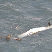 The commercial crab fishing vessel SUNUP is destroyed near the entrance channel in Humboldt Bay, Calif., January 24, 2021. The Coast Guard rescued the three people aboard the SUNUP after the vessel lost propulsion and collided with the jetties while attempting to transit through the entrance channel.