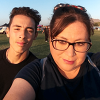 Julie Hansen with her son. The pair has stayed in Hansen's Fiat and with friends while she fights for nearly $13,000 tied up in her frozen state-issued Bank of America unemployment debit card..