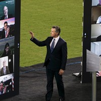 Gov. Newsom waves to virtual guests during the State of the State address at Dodger Stadium on March 9, 2021.
