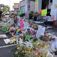 Memorial signs and flowers in front of Gold Spa in Atlanta, one of the locations where Suncha Kim, Hyun Jung Grant and Soon Chung Park were killed.