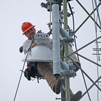 Yurok Connect Coordinator Duston Offins installs a new antenna on a tower in Requa during the implementation of the Yurok Connect Broadband Project.