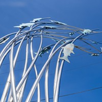 """A view looking up from near the base of one of the two new """"Homeward Leaping"""" stainless steel sculptures."""