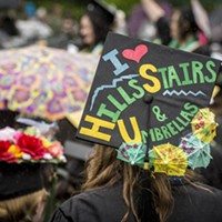 Ellinoa Blake, a critical race, gender and sexuality studies graduate, wears a mortarboard hat with one of HSU's informal mottos, which was very appropriate for this rainy day commencement ceremony.