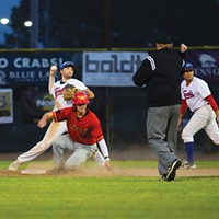 Crabs shortstop Aaron Casillas throws the ball over to first base after making the play at second for an out while facing the Alaska Goldpanners on Aug. 4 at Arcata Ball Park.