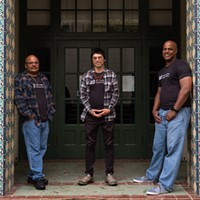 Mark Taylor, left, Tony Wallin and Eric Clark, far right, at the Humboldt State University campus