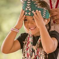 Dakotarose Scott, 5, of Klamath, adjusts her crown.