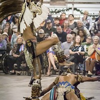 A packed house at Redwood Acres watched the eagle and jaguar dance by Aztec Dance and Drum group.