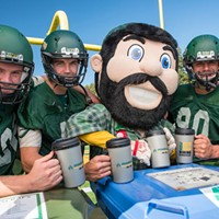 """Jacks football players and mascot """"Lucky"""" pose with reusable cups."""