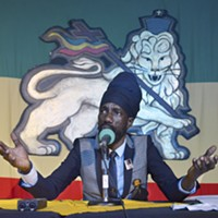 "Sizzla Kalonji addresses the media at a press conference after his show. Prior to the press conference, Kalonji's manager warned reporters not to ask any ""homophobic questions."""