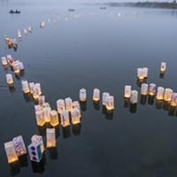 Personalized paper lanterns drift out onto Klopp Lake on Saturday night.