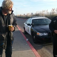 Captain Steve Watson talks to a homeless man vacating the sleeping area this morning.