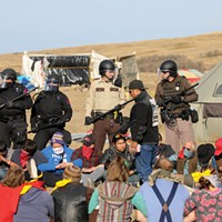 A group of protesters locked arms to create a barricade against police during a Morton County sheriff-led push to remove demonstrators from the pathway of the Dakota Access Pipeline on Oct. 27.