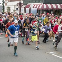 "The crowd of racers putting the ""sweat"" in ""sweater"" during Sunday's Ugly Sweater Run."