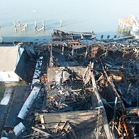 An overhead view of the remains of the commercial building.