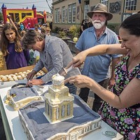 Shoshanna Rose (right), of Arcata, helped cut and serve the Creamery Building replica cake that building owners Lisa and Brian Finigan, of Arcata, brought to share with Fervor Fest attendees.