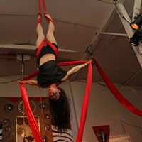 An aerialist performing at the soon-to-be-vacated Synapsis Studio.